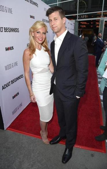 "Ashley and Paul Bernon at the premiere of ""Adult Beginners."""